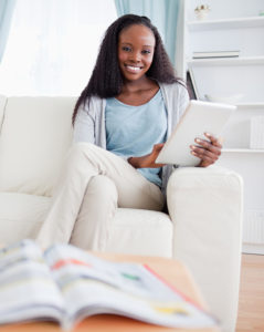 Woman using tablet on couch